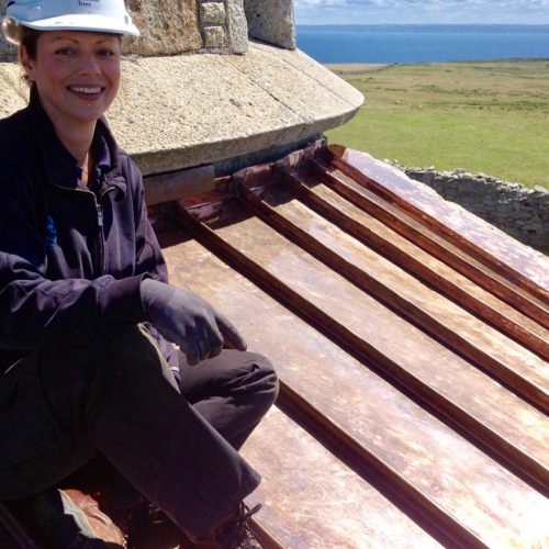 Rachel sat atop Lundy Lighthouse restored by Old Light Building Conservation